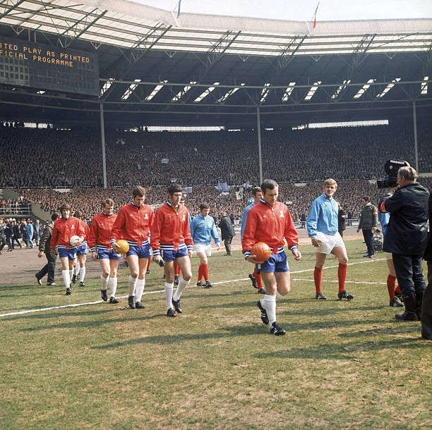 The Leeds United and Chelsea FC players come out at the start of the FA Cup Final at Wembley Stadium, London, 11th April 1970. Centre, right is...