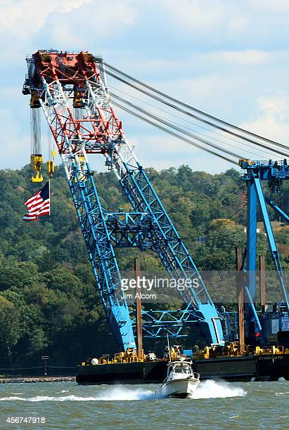 The Left Coast Lifter one of the world's largest floating cranes travels up the Hudson River to the site of the Tappan Zee Bridge October 6 2014 seen...