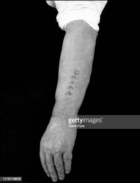 The left forearm of Holocaust survivor, Jack Kleinberg, showing the tattoo of his prisoner identification number, London, 1995. Kleinberg was a...