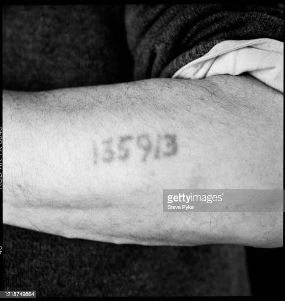 The left forearm of Holocaust survivor, Sam Piunik, showing the tattoo of his prisoner identification number, London, 1995. Piunik was a prisoner at...