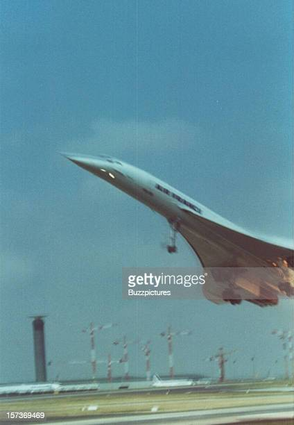 The left wing of supersonic passenger airliner Concorde, Air France Flight 4590, bursts into flame on take off from Paris Charles de Gaulle airport,...