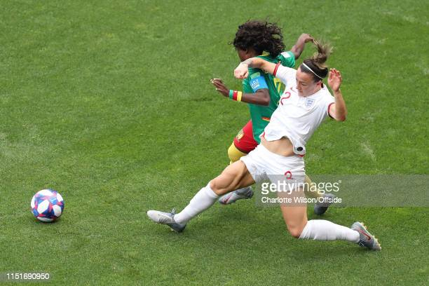 The leg muscles of Lucy Bronze of England ripple as she stretches for the ball during the 2019 FIFA Women's World Cup France Round Of 16 match...