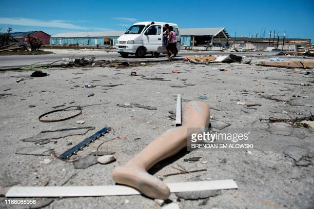 The leg of a dismantled mannequin is seen next to damage caused by Hurricane Dorian on September 5 in Marsh Harbour Great Abaco Island in the Bahamas...
