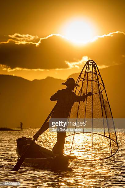 The leg rowing Intha fishermen is fishing at Inle Lake in Myanmar. Waking up in the pre-dawn hours and heading out in the mirror-like calm waters of...
