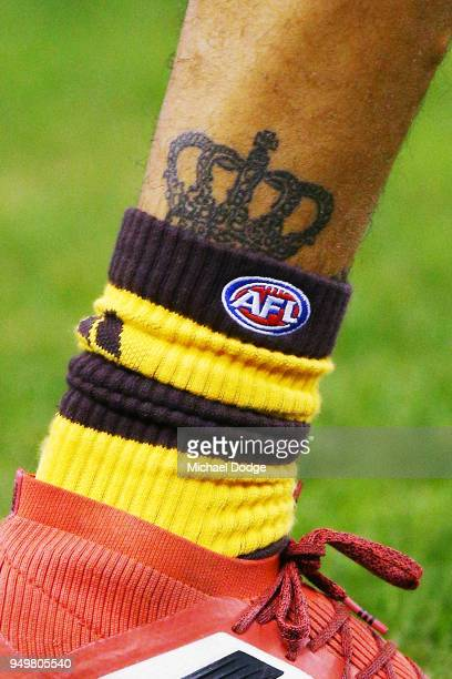 The leg tattoo of Jarman Impey of the Hawks is seen during the round five AFL match between the North Melbourne Kangaroos and the Hawthorn Hawks at...