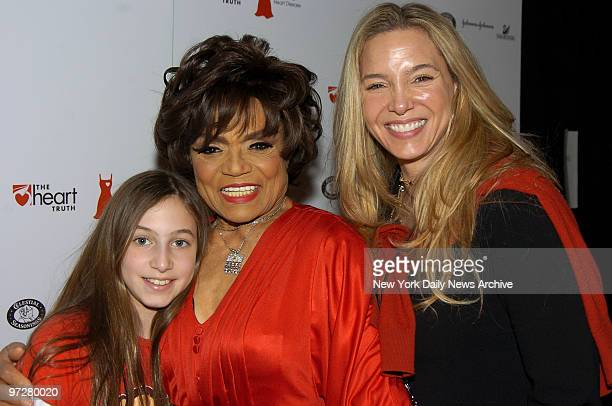 The legendary Eartha Kitt clad in a crimson Kai Milla gown gets together with her daughter Kitt and granddaughter Rachel backstage during the 2006...
