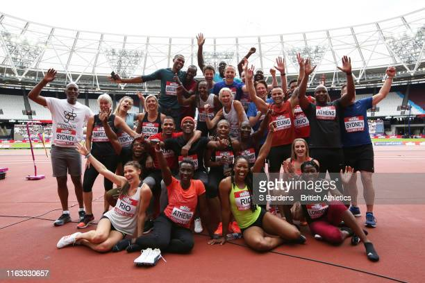 The Legends Mixed 4x100m athletes pose for a photo during Day Two of the Muller Anniversary Games IAAF Diamond League event at the London Stadium on...