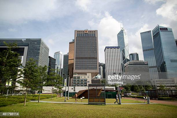 The Legislative Council Complex left the Chinese People's Liberation Army Forces Hong Kong Building center Bank of America Tower center right Bank of...