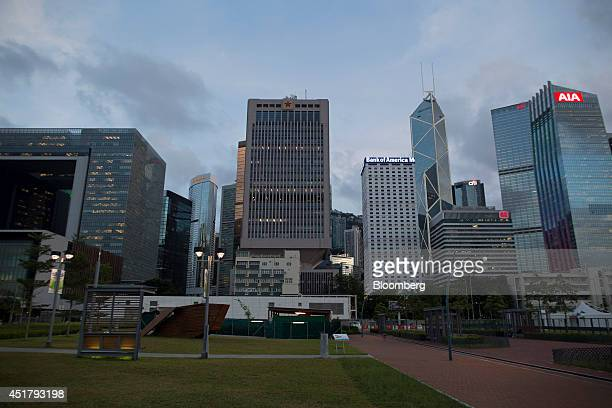 The Legislative Council Complex left the Chinese People's Liberation Army Forces Hong Kong Building center Bank of America Tower sixth right Bank of...