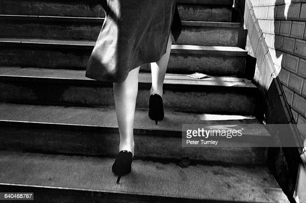 The legs of a woman leaving the Paris Metro station at St GermaindesPres