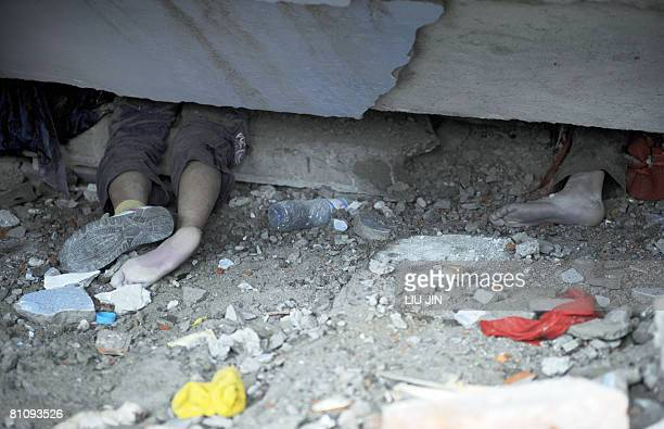 The legs of dead pupils rest under the rubble of a collapsed elementary school in Yingxiu of Wenchuan county after a quake with a magnitude of 78...