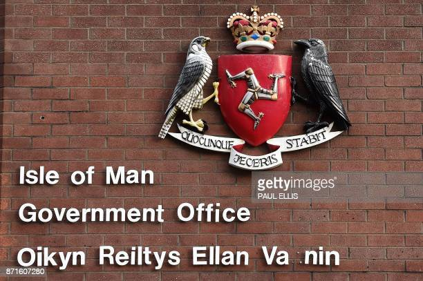 The Legs of Man symbol is pictured on a crest outside the Isle of Man Government Office in Douglas on the Isle of Man an island in the Irish Sea off...