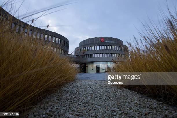 The Leica logo sits above the Leica Camera AG headquarters in Wetzlar Germany on Tuesday Nov 28 2017 German factory orders unexpectedly rose for a...