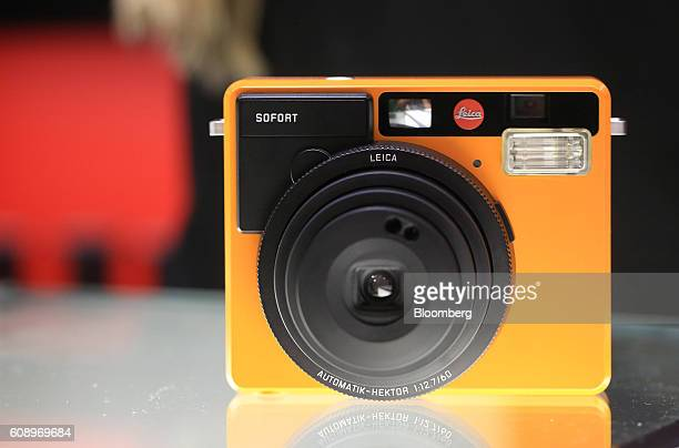 The Leica Sofort instant camera sits displayed on the Leica stand during the Photokina photography trade fair in Cologne Germany on Tuesday Sept 20...