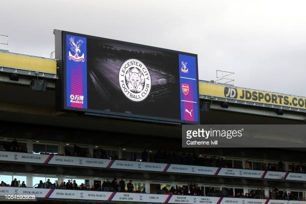 The Leicester City crest is displayed on the big screen following a helicopter crash outside the King Power Stadium yesterday prior to the Premier...