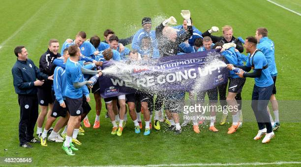 The Leicester City first team squad celebrate during a photocall and press conference at the Leicester City training ground on April 07, 2014 in...