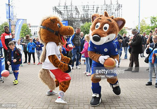 The Leicester City mascot enjoys the pre match atmopsehre before kick off during the Premier League match between Leicester City and Burnley at The...