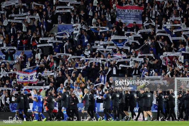 The Leicester City squad and staff show appreciation to their fans after the Premier League match between Leicester City and Burnley FC at The King...