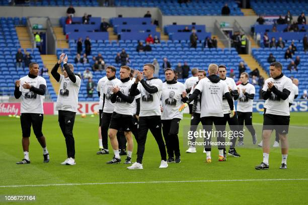 The Leicester City team acknowledges the fans while wearing a commemorative shirt for Vichai Srivaddhanaprabha during the Premier League match...