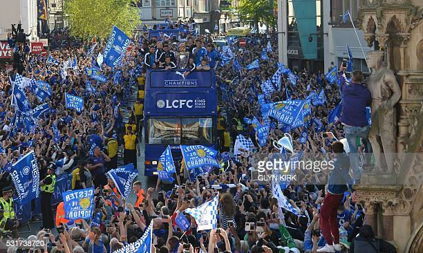 The Leicester City team take part in an opentop bus parade through Leicester to celebrate winning the Premier League title on May 16 2016 KIRK