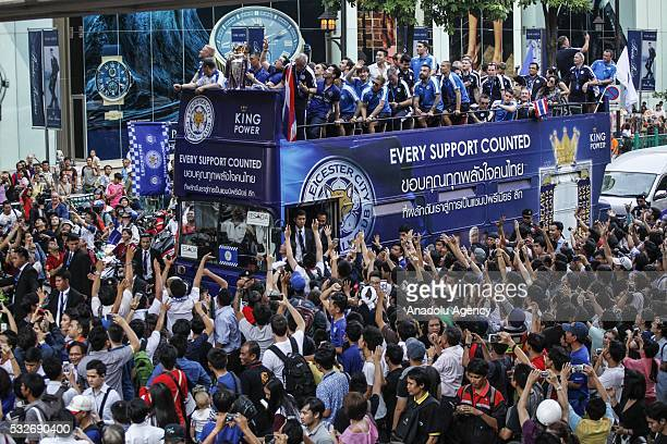 The Leicester City team take part in an opentop bus parade through Bangkok downtown to celebrate winning the Barclays Premier League title in Bangkok...