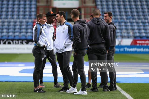 The Leicester City team talk on the pitch prior to the Premier League match between Huddersfield Town and Leicester City at John Smith's Stadium on...