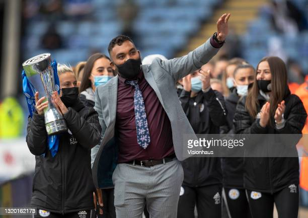The Leicester City women's team manager Jonathan Morgan and captain Sophie Barker parade the Championship trophy at half time during the Premier...
