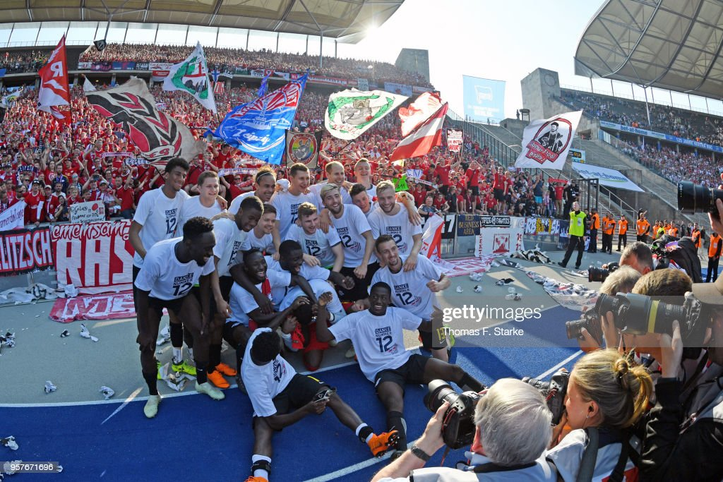 The Leipzig team celebrates after the Bundesliga match between Hertha BSC and RB Leipzig at Olympiastadion on May 12, 2018 in Berlin, Germany.