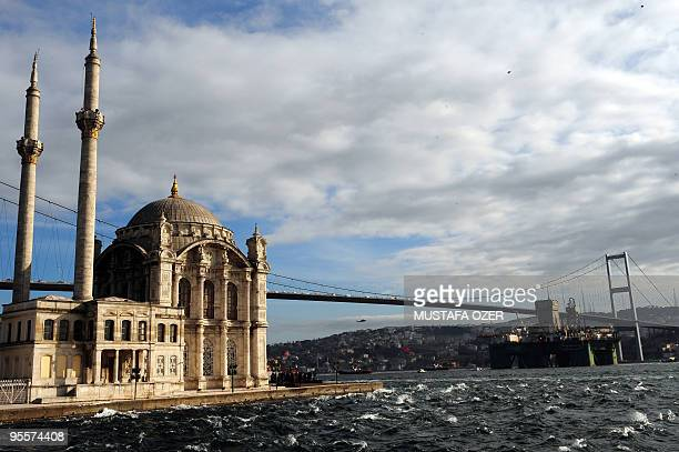 The Leiv Eiriksson one of the world's largest oil drilling platforms passes under the Bosphorus bridge in Istanbul on December 31 on the Bosphorus...