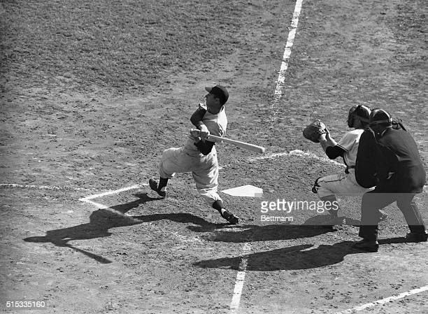 The lengthening shadows at home plate symbolize the dusk of a magnificent career in baseball that of Joe DiMaggio who joined the New York Yankees in...