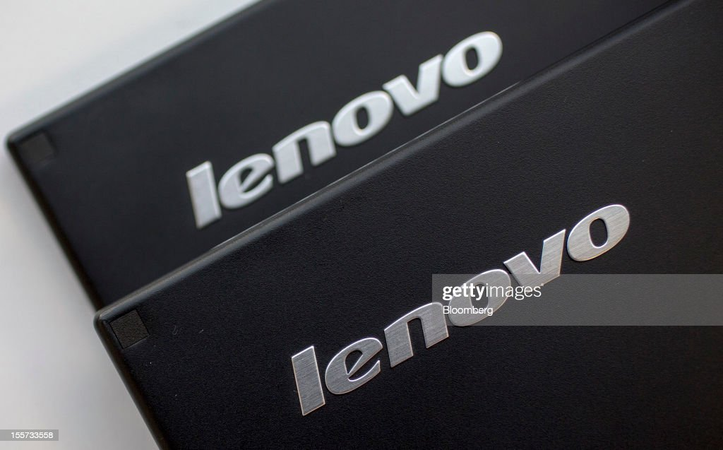 The Lenovo Group Ltd. logos are displayed on Lenovo screens arranged for a photograph in Hong Kong, China, on Wednesday, Nov. 7, 2012. Lenovo announces second quarter earnings today. Photographer: Jerome Favre/Bloomberg via Getty Images