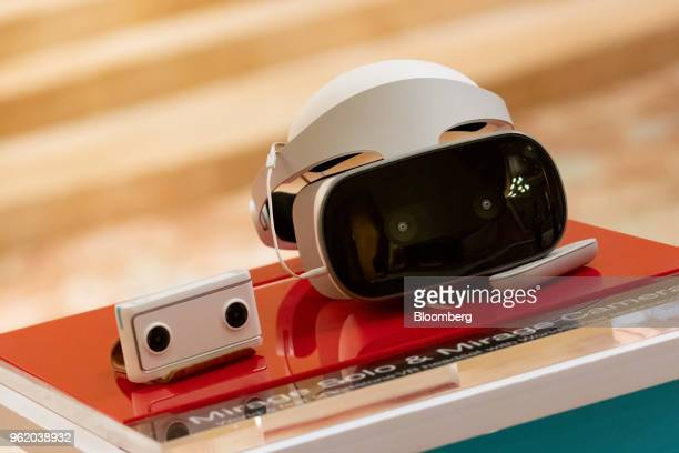 The Lenovo Group Ltd Mirage Solo VR headset with Mirage Camera are displayed at a news conference in Hong Kong China on Thursday May 24 2018 Lenovo...