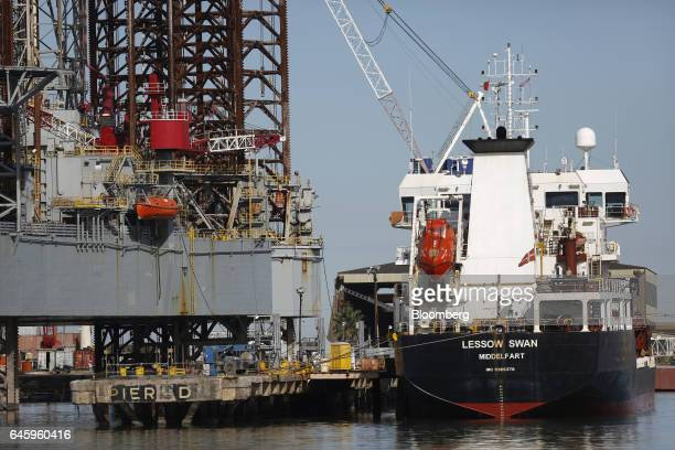 The Lessow Swan chemical tanker sits docked in front of a retired Ensco Plc oil drilling platform at the Port of Galveston in Galveston, Texas, U.S.,...