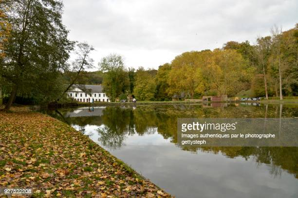 The 'l'Etang du Moulin' and abbey in middle autumnal nature