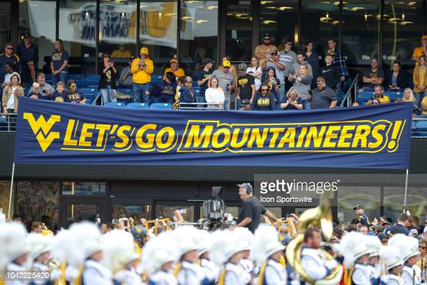 The Lets Go Mountaineers banner is hung for the Mountaineers team introduction prior to the college football game between the Kansas State Wildcats...