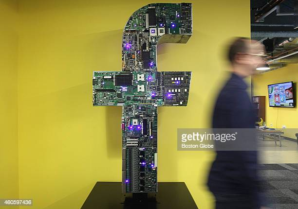 The letter 'f' stands in a corner of the Facebook offices in Cambridge Mass on December 10 2014