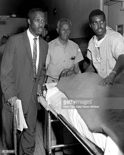 The letter opener still protruding from his chest the Rev Martin Luther King is wheeled into Harlem Hospital