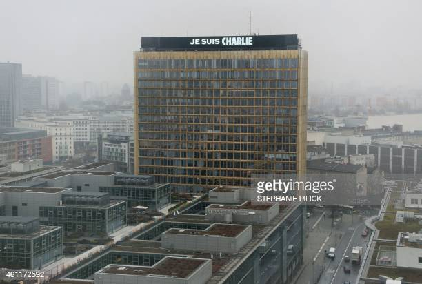 """The lettering """"Je suis Charlie"""" is displayed on the roof of the German Axel Springer publishing group headquarters in Berlin on January 8, 2015 in..."""