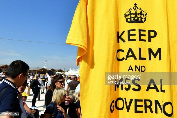 The lettering on a shirt reads 'Keep calm and M5S to the government' ahead of the congress of Italy's populist Five Star Movement in Rimini on...