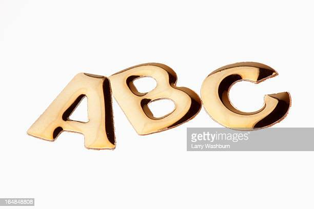 The letters 'ABC' in gold lettering