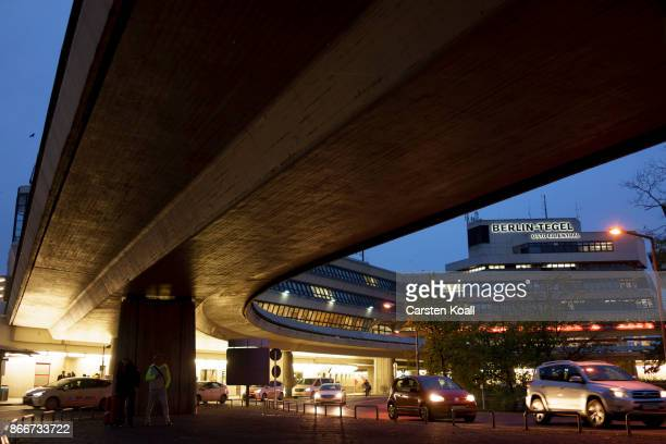 The letters of the name of the airport BerlinTegel Otto Lilienthal are illuminated beside the control tower at Tegel Airport on October 26 2017 in...