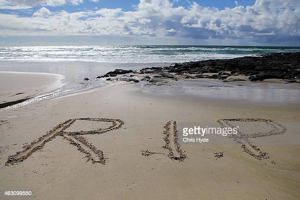 The letters RIP on Shelly Beach in memory of shark victim Tadashi Nakahara on February 10 2015 in Ballina Australia Beaches in northern NSW remain...