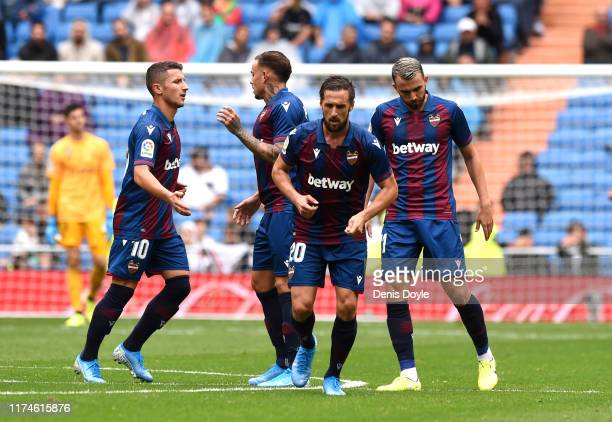 The Levante UD team celebrate their sides second goal during the La Liga match between Real Madrid CF and Levante UD at Estadio Santiago Bernabeu on...