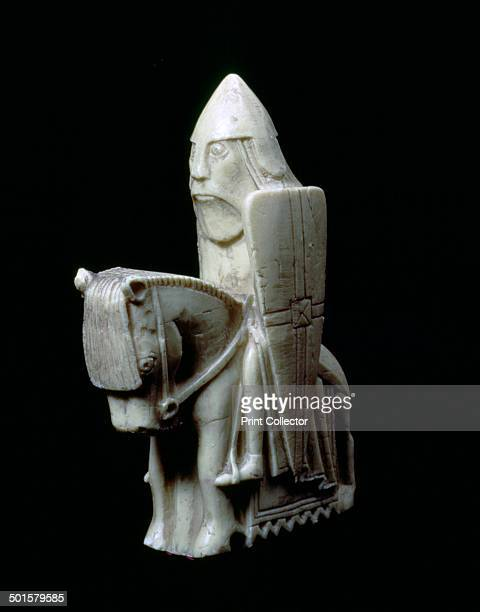 The Lewis Chessmen c1150c1200 A Knight piece from a collection of ninetythree found at Uig on the Isle of Lewis Outer Hebrides Scotland Taking the...