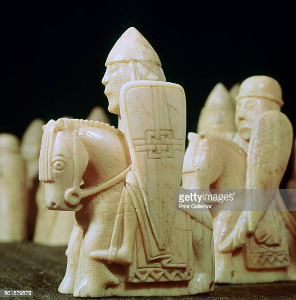 The Lewis Chessmen c1150c1200 Knight pieces from a collection of ninetythree found at Uig on the Isle of Lewis Outer Hebrides Scotland Taking the...
