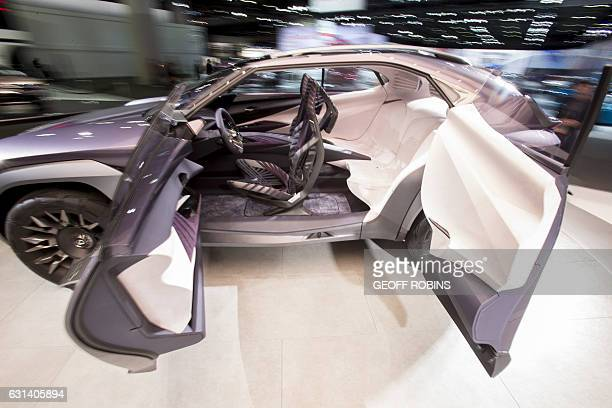 The Lexus UX concept SUV rotates on a stand at the company's booth at the 2017 North American International Auto Show in Detroit Michigan January 10...