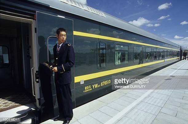 The Lhasa Beijing train stop in a Tibetan train station Tibet in China THE LHASA BEIJING TRAIN STOP IN A TIBETAN TRAIN STATION TIBET