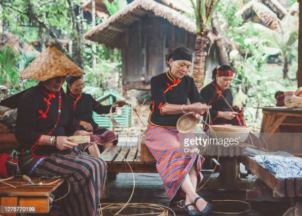 the li ethnic minority groups in china - tribal art stock pictures, royalty-free photos & images