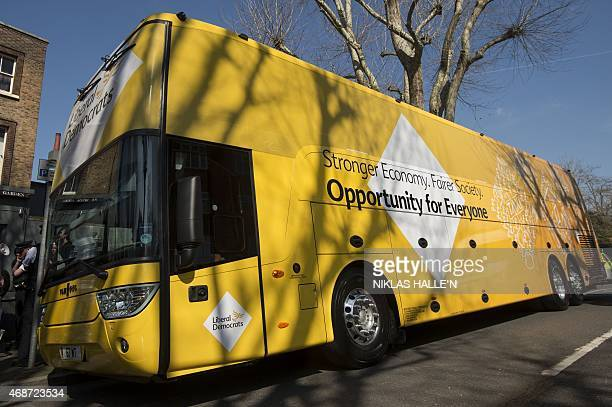 The Liberal Democrat election bus parks up in Surbiton Kingston on Thames during an election campaign stop on April 6 2015 in London Campaigning is...
