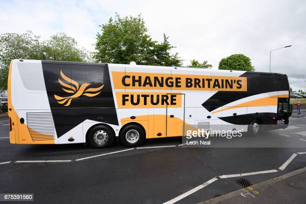 The Liberal Democrat party campaign bus is unveiled at an event at the Harts Boatyard on May 1 2017 in Surbiton England In an attempt to gain a...
